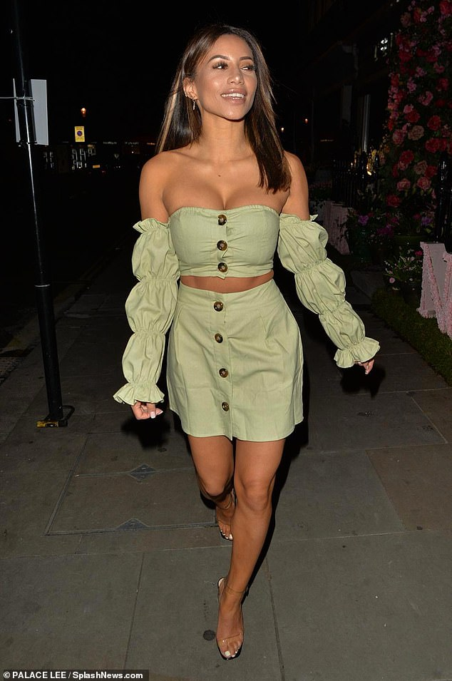 Style savvy: Flashing a hint of her toned midsection, the model cut a chic figure in a bralet with ruched balloon sleeves, teamed with a matching A-line skirt