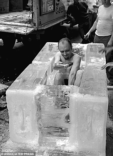 Randi, who was known for his ability as an escape artist, sits in a coffin like structure of blocks of ice during a stunt in New York on June 7, 1960