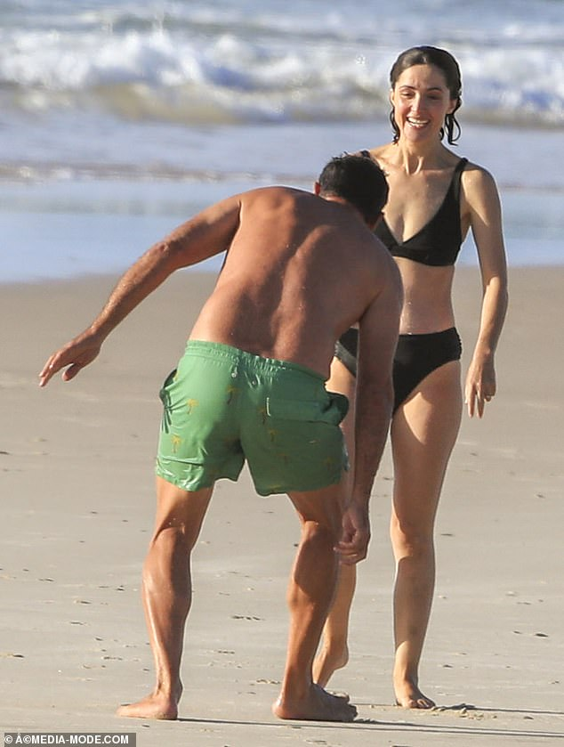 Fun in the Sun: The actress, mother of two, beamed as she took a dip in the ocean before returning to shore with Bobby for some hijinks