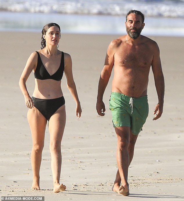 Hey, handsome: Rose showed off her impressive toned figure in a black bikini while Bobby looked good in green board shorts
