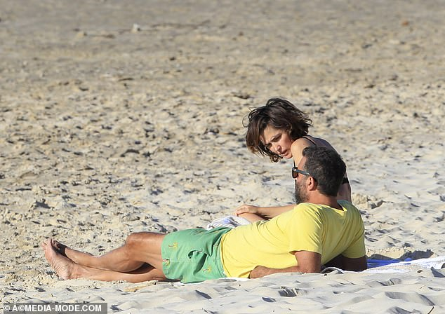 Relaxed: They relaxed on their beach towels and talked before packing up their things and going home