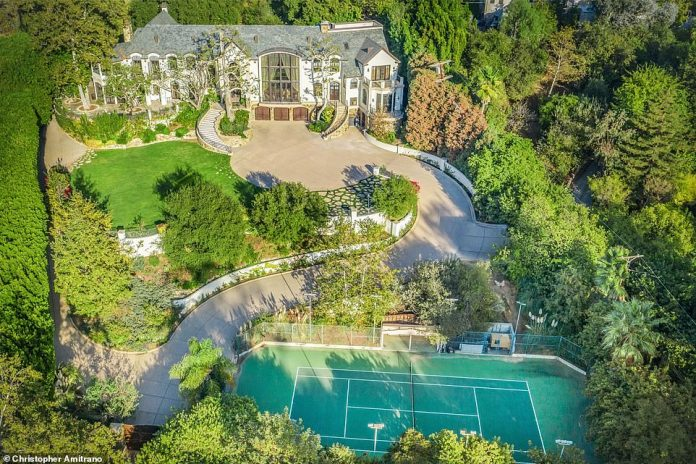 Sprawling: the house has seven bedrooms, room for 35 cars and a tennis court