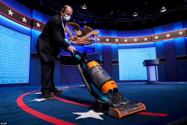 The carpet is vacuumed as final preparations are made ahead of the second and final presidential debate
