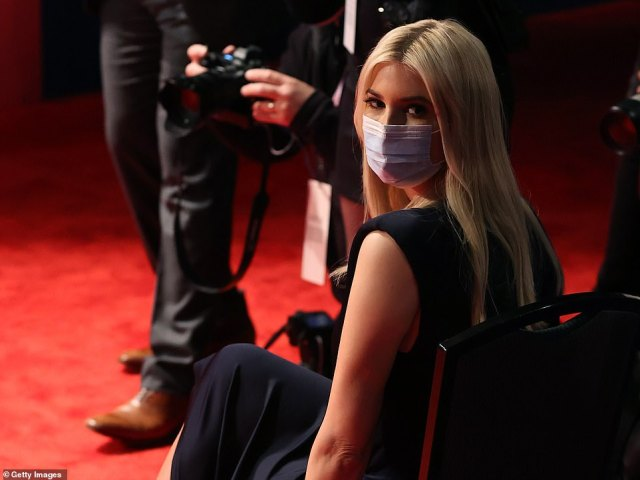 Ivanka Trump sits with her mask still in place as the candidates took the stage