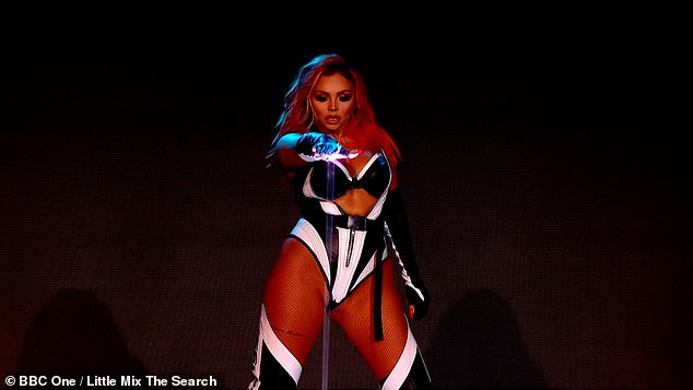 Style: Jesy put on a scorching display in a black bra that showcased her washboard abs