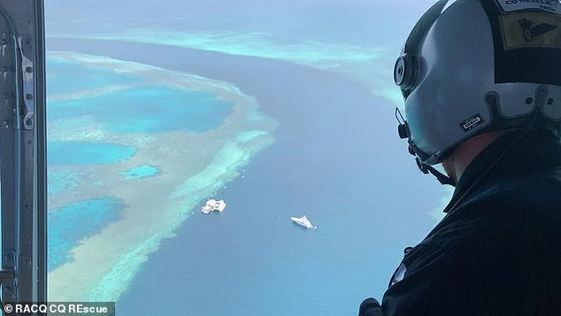 A man is in a critical condition after he was attacked by a shark on the Great Barrier Reef. Pictured: a rescue helicopter on its way to the scene