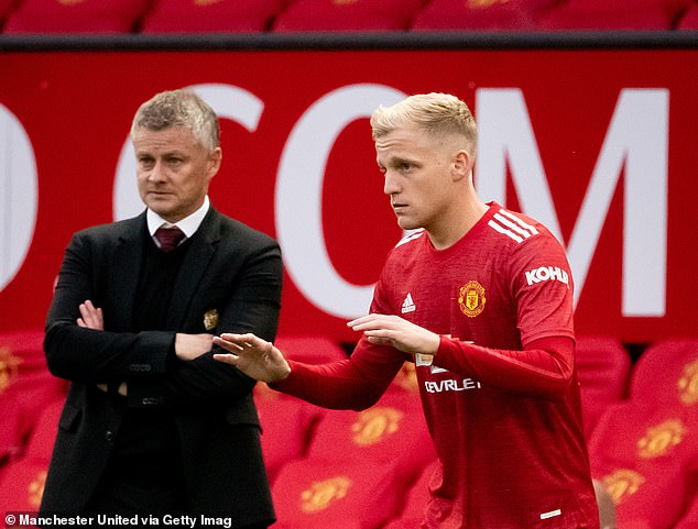 Van de Beek however has been promised he will get game time by Ole Gunnar Solskjaer (left)