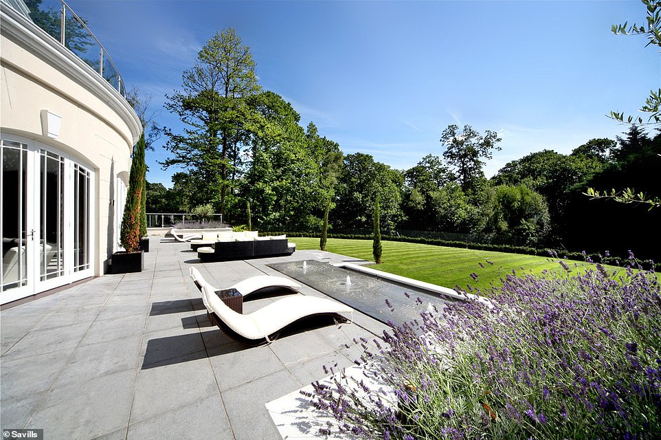 The house has two water features in the back garden, along with plenty of outdoor seating space