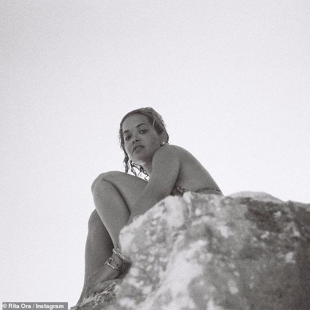 Flashback: Rita also impressed by posing on top of a cliff, captioning the collection of scorching shots: `` Part 2 on my camera x summer 2020 ''