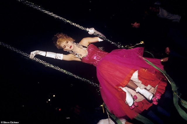 Drag queen on a swing: Roller rink turned nightclub the Roxy in 1990. Eichner writes that the Roxy 'was my first love as far as mega clubs'. He recalled, 'Roller skaters would wizz around while Madonna music blasted from the sound system. A Drag queen in a rose-colored formal gown and pink roller skates swung from a swing high above the dance floor. All around the periphery club kids pranced around drinking Absolut and cranberries they got for free with drink tickets. Upstairs in the VIP area supermodels like Naomi Campbell popped champagne with rock stars'