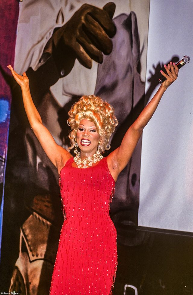 Primtime drag: RuPaul is seen at Club USA in 1993. 'When this photo was taken RuPaul had instantly transformed from a club personality just known in NYC into an international superstar,' the author recalls. 'This photo was taken during a performance of Supermodel (You Better Work). The song became a hit and was on heavy rotation on MTV'