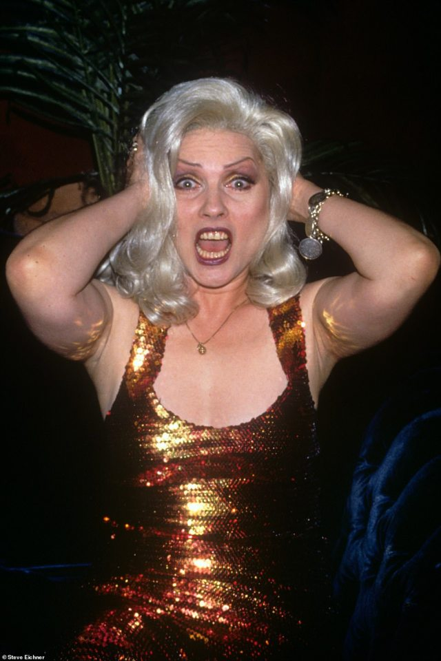 Sparkle and shine: Debbie Harry is seen at the Roxy in 1994. 'I love the energy and the pose and her gold sequin dress. This photograph wound up being published in a magazine with the caption ''Is that Debbie Harry or a drag queen doing Debbie Harry'',' Eichner says