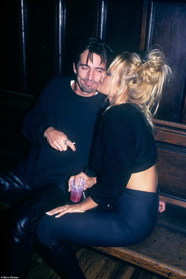 Newlyweds: Tommy Lee and Pamela Anderson at the Limelight in 1995. This photo was taken when they were at the height of their fame - she was on Baywatch and he was in Motley Crue and they were recently married just a few months before this photo was taken. The author writes, 'I remember for some reason it is during the day, I don't know if they were there promoting something or just checking out the club but you know they're sitting on a church pew because the Limelight was an old church that was bought by Peter Gatien and turned into a night club'