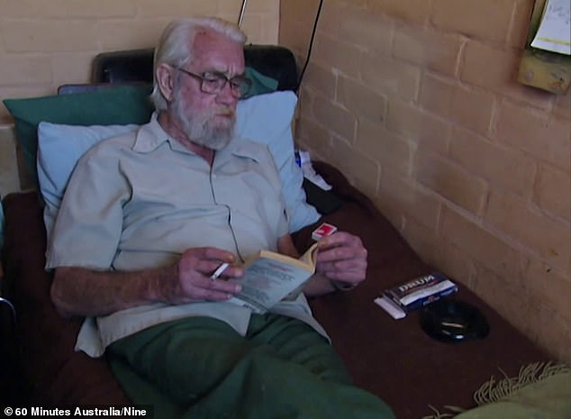 Len Lawson spent his last 15 years in the minimum and medium security sections of Grafton jail. He is pictured reading a true crime book - which featured a chapter on his own appalling offending - in his cell at Grafton four years before he dropped dead aged 76