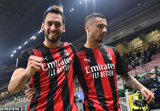Turkey internationalCalhanoglu (L) has been a key player in Milan's superb start to the season