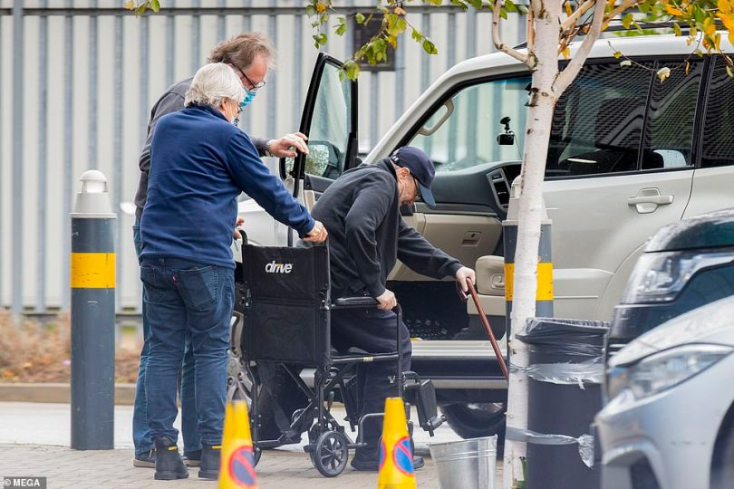A helping hand:The legendary hitmaker, 69, emerged from a car while using a stick for assistance before he was helped into a wheelchair on Tuesday, in a sighting that comes after the iconic hitmaker underwent multiple back surgeries, which have left him struggling to stand