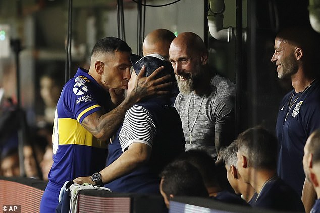 Carlos Tevez greeted Diego Maradona with a kiss before the final day of last season
