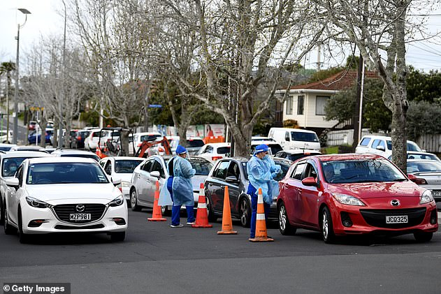 New Zealand was declared coronavirus-free in June after a strict national lockdown and has seen small outbreaks since then (coronavirus testing in Auckland, pictured above).