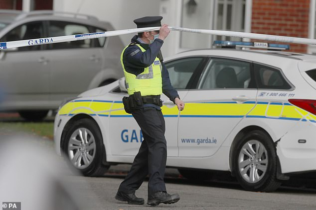 Gardai at a house in Llewellyn, Ballinteer, south Dublin, after the bodies of a woman and two young children were discovered