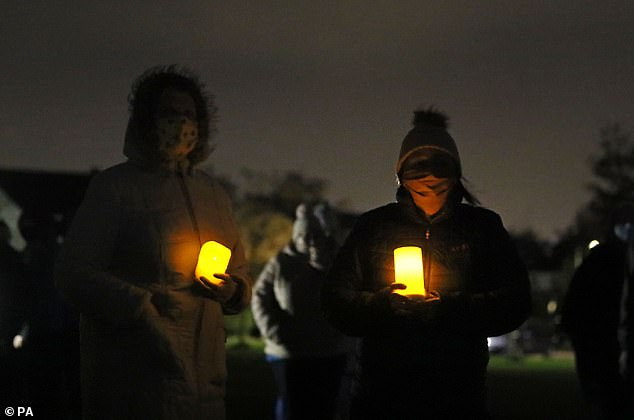 People at a candlelight vigil at the Llewellyn estate in Ballinteer, south Dublin