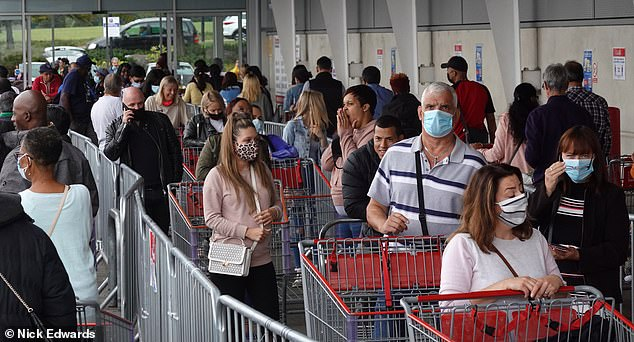 Pictured: Long Queues at Costco, Croydon. Humans are 'foragers' just like small mammals in the wild, researchers say
