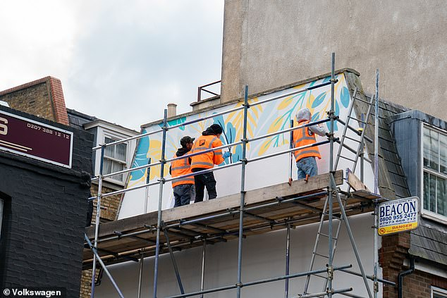 Each mural took between three and five days to paint. The advertising boards will remain up for one month, Volkswagen UK said