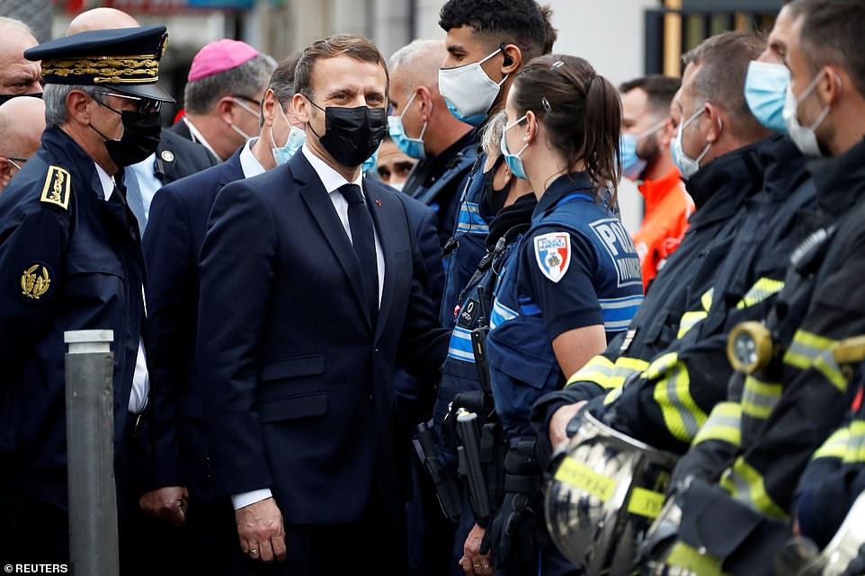 Emmanuel Macron arrives at the scene of the attack, where he spoke with paramedics and police officers
