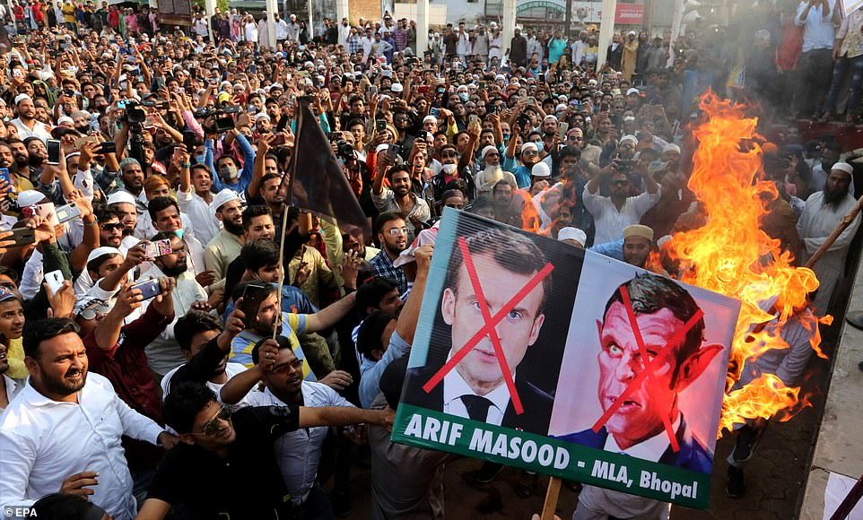 Indian Muslims burn posters of Emmanuel Macron during protest against his defence of cartoons of the Prophet Mohammed