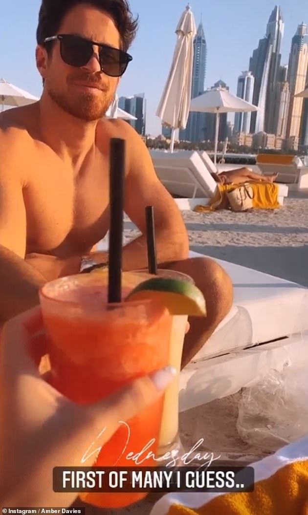 Romance is alive:Welsh beauty Amber tapped into full relaxation mode with the shirtless hunk as they sipped on cocktails