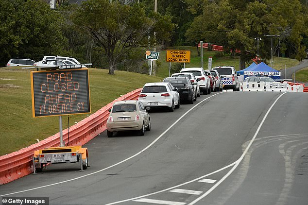 Ms. Palaszczuk is reportedly awaiting advice from the state's chief health officer and is likely to just extend the Sunshine State's border bubble with northern New South Wales (Image: Cars on the Queensland-New South Wales border in Coolangatta)