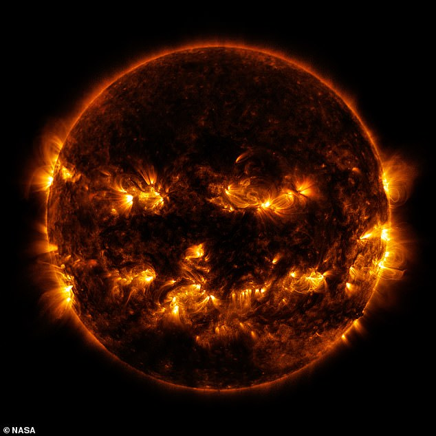 NASA posted another spooky photo that was out of this world - the sun glowing with a pumpkin face. The haunting illuminated 'face' smoldered on the sun's surface in 2014 when activity reached 'solar maximum', meaning more sun spots occurred
