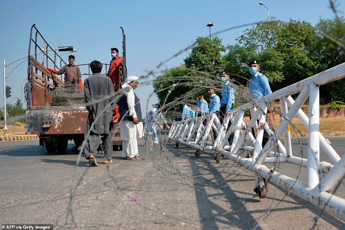 PAKISTAN: Security personnel put up barbed wire on a road that leads to the French embassy in Islamabad, a day after a guard was stabbed at a French consulate in Saudi Arabia amid high tensions between France and the Muslim world