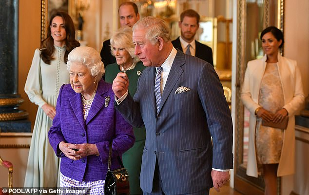 Prince Charles walks with Queen Elizabeth II and his wife Britain's Camilla, and his sons and their wives, Duke and Duchess of Cambridge, and Duke and Duchess of Sussex during a reception to mark the 50th Anniversary of the investiture of The Prince of Wales at Buckingham Palace in London on March 5 2019
