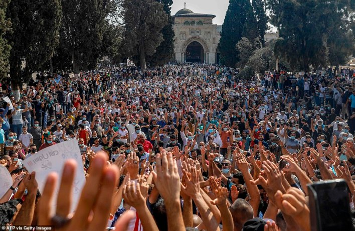 Palestinians gather to protest against the French President, in the al-Aqsa mosque compound, in the Old City of Jerusalem