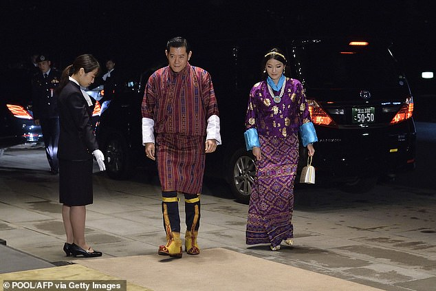 King Jigme Khesar Namgyel Wangchuck, 40, with his wifeQueen Jetsun Pema, who, at 30, is the youngest queen in the world. The royal couple both celebrated the union of their younger siblings yesterday. Pictured: the King and Queen of Bhutan in Japan in 2019