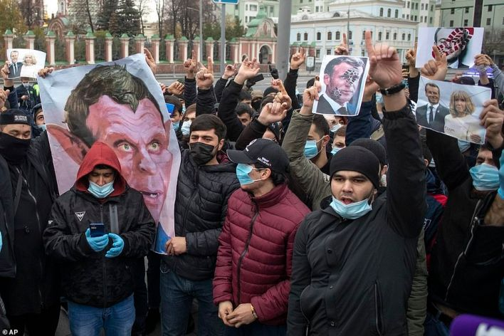 Protestersgather outside the French embassy in Moscow to protest against caricatures of the Prophet Muhammad, in Russia