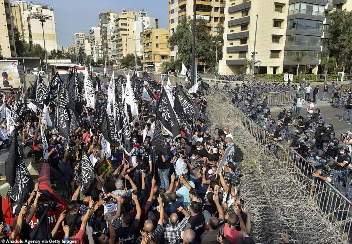 Tight security outside the French Embassy in Beirut as Lebanese protesters gather to decry Macron's remarks. Some at the rally are seen holding flags and symbols of Hizb ut-Tahrir, an international Islamic political organisation