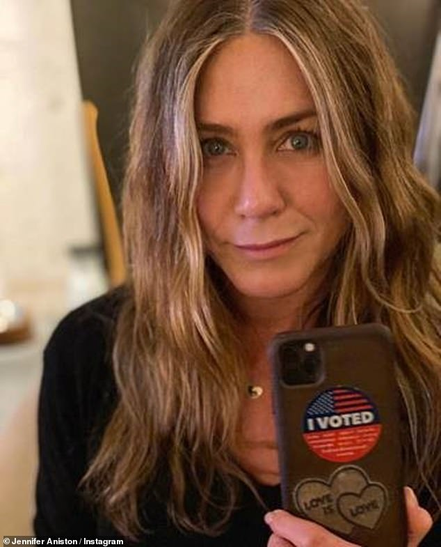 Love:Jennifer Aniston took to Instagram to reveal that she has voted wearing the Maya Brenner x Nyakio Grieco Enamel Gold Unity Pendant