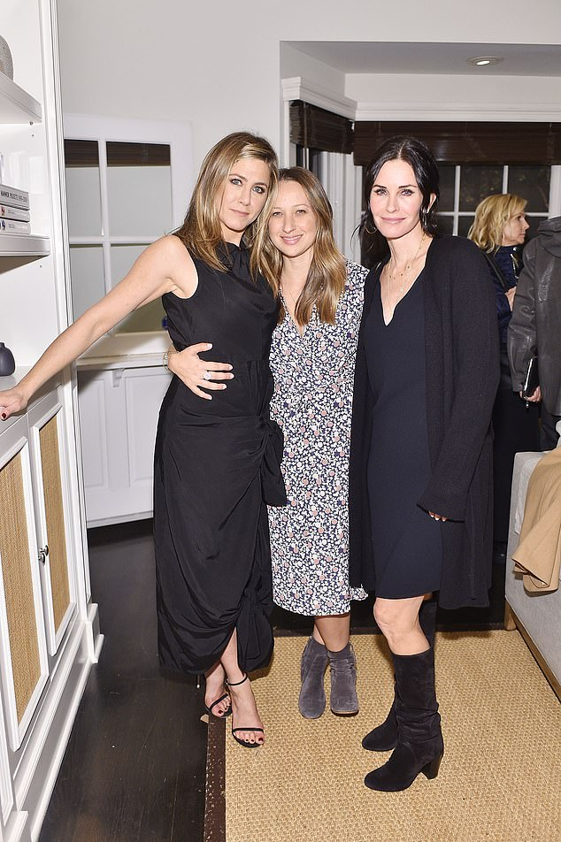 She has famous friends: With Jennifer Aniston, left, and Courteney Cox, right, in 2015