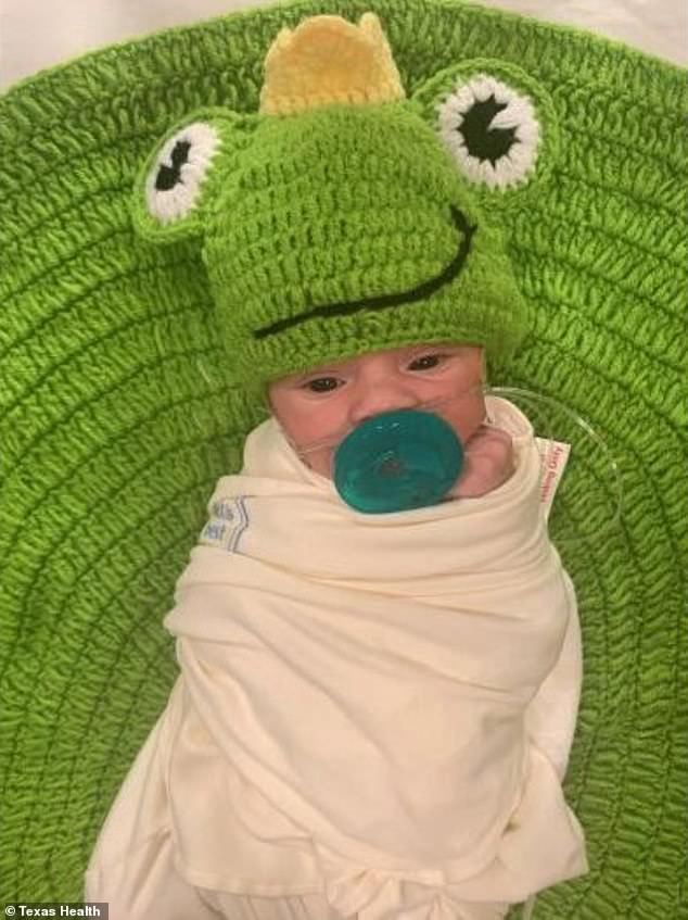 Precious: One newborn was dressed as a frog on a lily pad in honor of Halloween