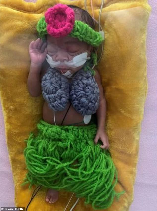 Adorable:One sleeping baby was dressed as a hula dancer complete with a knit coconut-shell bra and a grass skirt