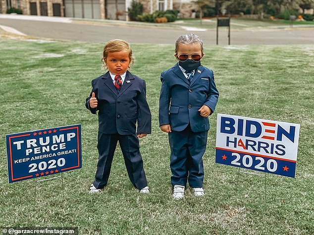 Hilarious: Adrea Garza, 36, from Edmond, Oklahoma, dressed up her twins Koti and Haven as Donald Trump and Joe Biden for Halloween