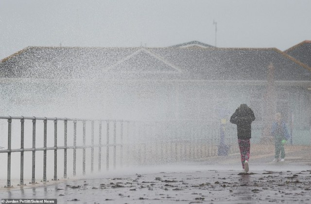 Children get soaked by the enormous waves battering the coastline yesterday morning at Southsea in Hampshire