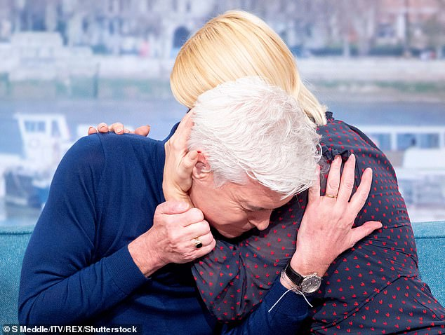Candid: Late last year, the TV star admitted he still has to 'come to terms' with his life after publicly coming out in February (pictured with Holly Willoughby)