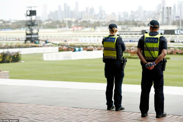 Members of Victoria Police look on at Flemington Racecourse during Derby Day despite there being no punters