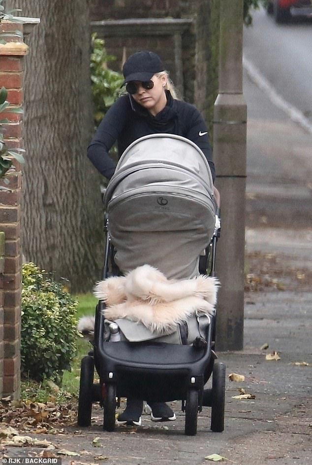 Multi-tasking:The reality star could be seen chatting animatedly on the phone to someone as she pushed her little one around in the pram