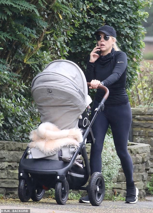 Comfy:Lydia Bright cut a casual figure in a black long-sleeved top and matching gym leggings as she takes daughter Loretta for a stroll in Loughton, Essex, on Friday