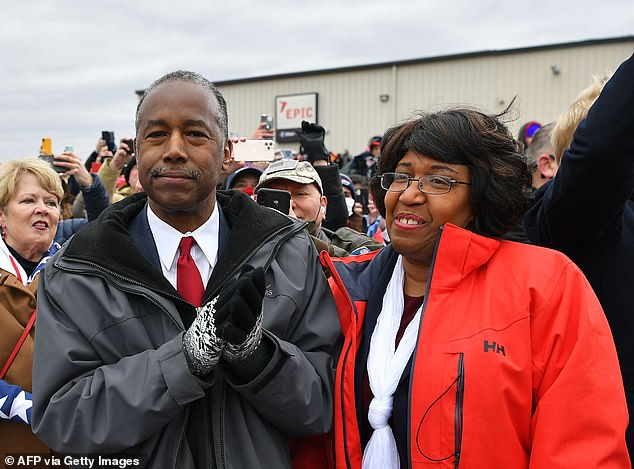Housing and Urban Development Secretary Ben Carson (left), a retired neurosurgeon, and his wife Candy (right) were in Trump's Michigan crowd, not wearing masks. The Carsons were born and brought up in Detroit