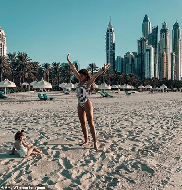 Happy days: Earlier this week, the model admitted they were forced to remain in Dubai after their daughter fell ill, with Amy devoting her time to nursing her back to full health