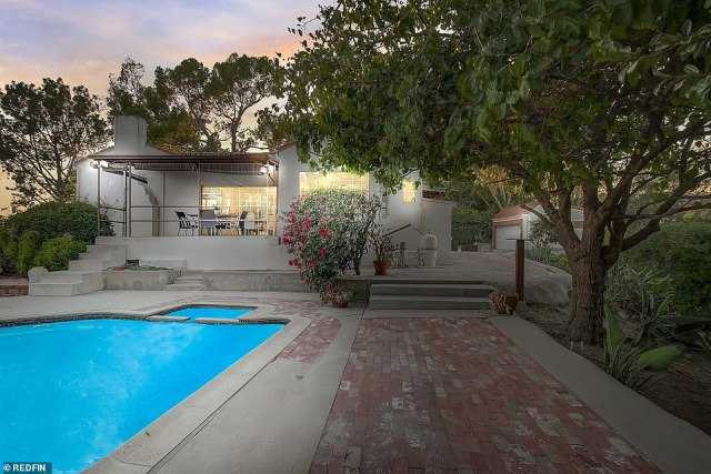 Up for sale, again: The single-story 1920s Los Feliz home has been listed on Redfin since Tuesday. The gated abode is on sale for $2.2million